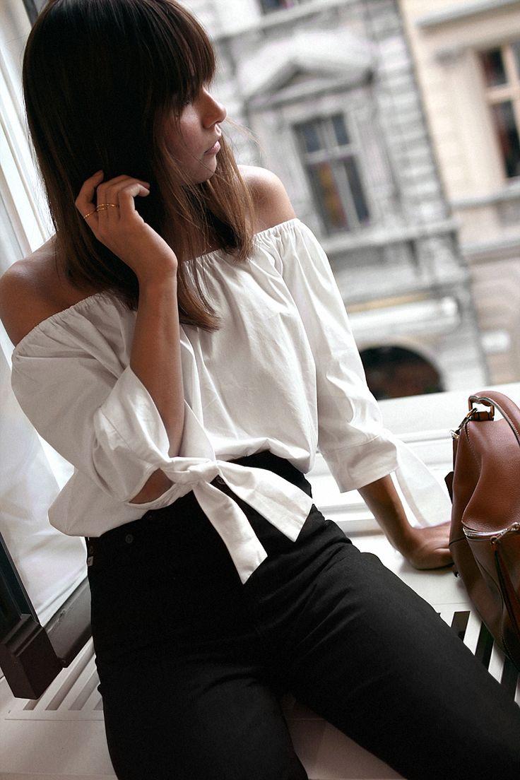 Nisi is wearing: Loewe Puzzle Bag, Black Mom Jeans, Off-the-shoulder top - teetharejade.com