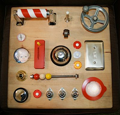 I would love to have a homemade Busy Board - switches, slides, wheels, door thingy-ma-bobs etc.
