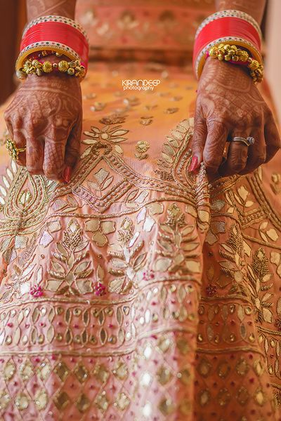 Bridal Details - Gotta Patti Bridal Details on a Lehenga | WedMeGood #wedmegood #indianbride #indianwedding #gottapatti #bridaldetails #peach #pink