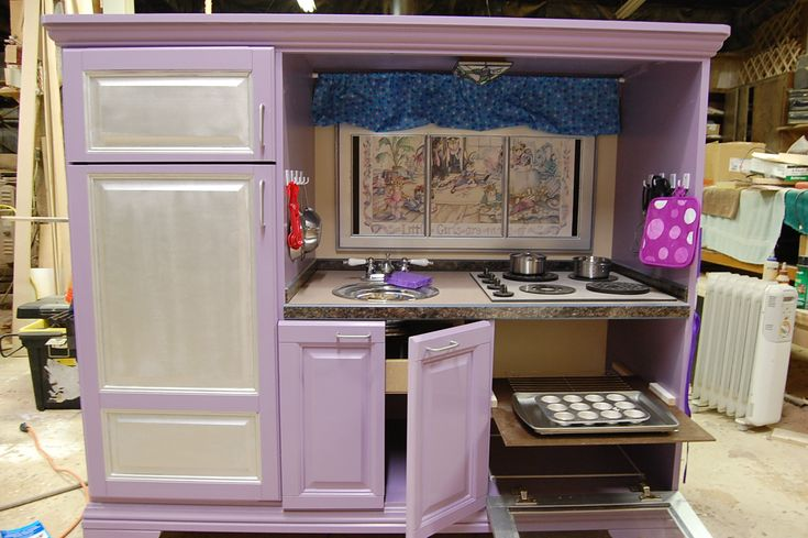We made this adorable kitchen from an older style entertainment center!