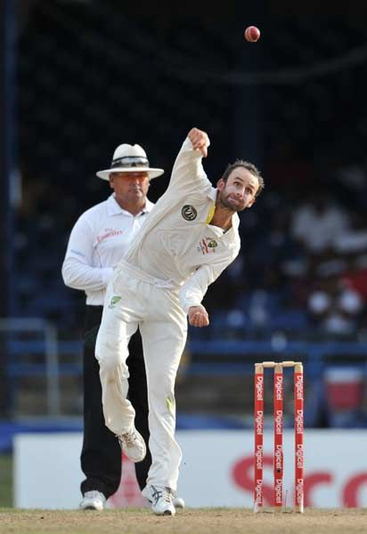 Australian bowler Nathan Lyon delivers during the second day of the second-of-three Test matches between Australia and West Indies April 16, 2012 at Queen's Park Oval in Port of Spain, Trinidad.