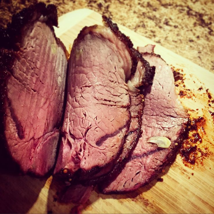 Mom's BBQ Roast Beef, slow roasted and studded with garlic cloves, rubbed in rosemary olive oil, kosher salt, and freshly ground pepper, then finished with BBQ sauce. The perfect main for your Friday backyard meal.