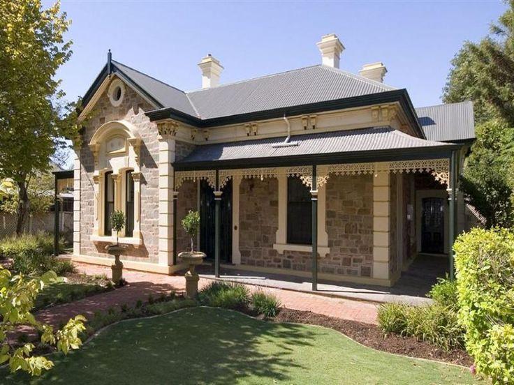 Bluestone colonial house exterior with verandah & landscaped garden - House Facade photo 185919