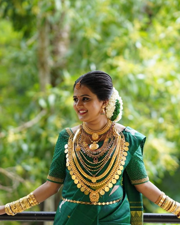 Latest Pics Of Kerala Brides: Image May Contain: 1 Person, Outdoor