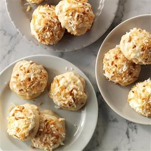 Coconut Clouds Recipe -Coconut lovers will have extra reason to celebrate when they taste these cake-like drop cookies. The generous frosting and coconut topping make them a hit at holiday cookie swaps. —Donna Scofield, Yakima, Washington