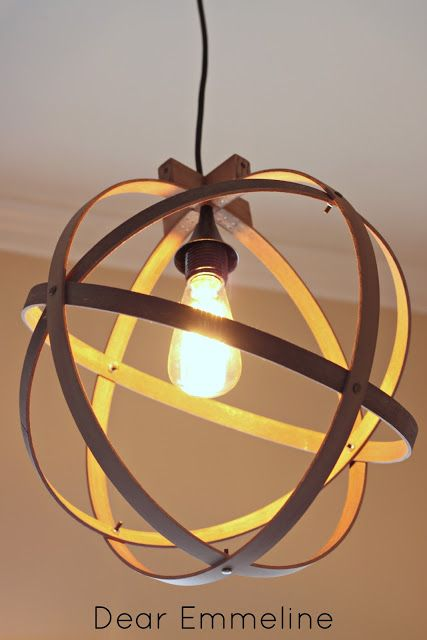 DIY pendant light from embroidery hoops (Love the look of this...very Frank Loyd Wright)