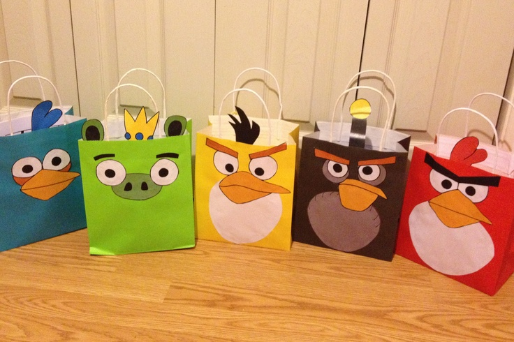 These are the goody bags I made for my son's Angry Birds birthday party this weekend!  I used the free printable template from:  http://www.thepartyanimal-blog.org/angry-birds-balloons-free-templates.  They designed them for balloons but they work great on goody bags too.  Simply print, cut and glue!  Done! #angrybirds