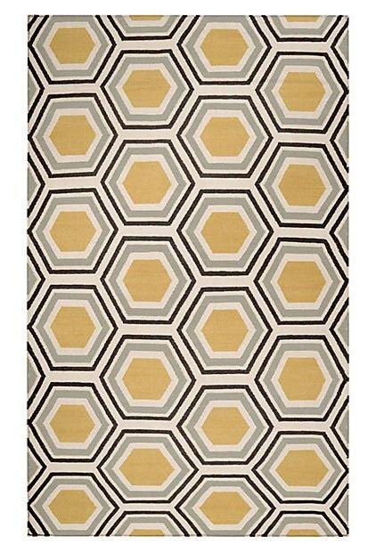 hexagons in grey, gold, black, cream.