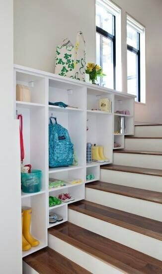 Steps to basement -> shelving for renter's boots, etc.
