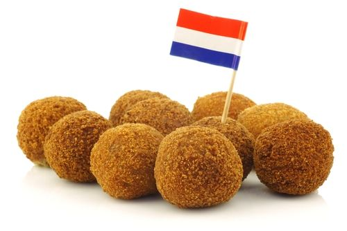 #Bitterballen. Bitterballen are deep-fried snacks that are ubiquitous in cafes and bars all over the Netherlands. These savory orbs are battered in a crunchy breadcrumb coating and filled with a gooey mixture of chopped beef, beef broth, flour, butter, herbs and spices. They are typically served with mustard for dipping.