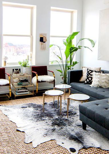 Go from monochromatic and sleek to warm and modern by topping your living room rug with an animal-inspired piece.