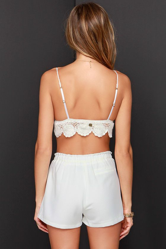 When it comes to killer Boho tops like the Billabong Barely There Ivory Crochet Bralette Top, we're all in! This off-white crocheted triangle top is flirty, festive, and perfectly retro, with convenient updates like an elastic waistband and adjustable spaghetti straps. Pair with flare jeans or shorts for the perfect sun-filled day. Small metal logo tag at back. Cups are lined in jersey knit. 100% Cotton. Hand Wash Cold.