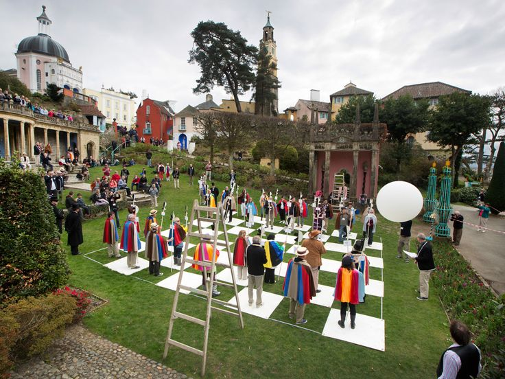 Enthusiasts of Patrick McGoohan's 60s TV series The Prisoner re-enact one episode's human chess game at the annual fans' convention in Portmeirion, where the cult show was filmed Photograph: David Levene for the Guardian