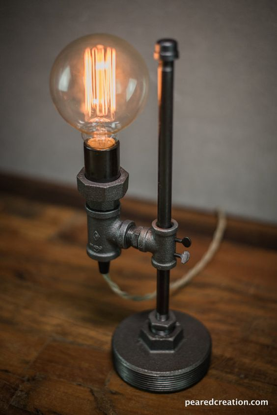 This industrial desk lamp is uniquely designed so that the height may be adjusted with a turn of a key. Each comes with the 40 watt vintage style edison bulb seen in the picture. The lamp also features a retro style cloth covered cord and inline switch. THE DETAILS: - Cord Length: 72 in. - Height: 15in. - Width: 4.5 in. - Depth: 7 in. - UL Listed Components - Made for 110-120V all others use appropriate voltage converter We package our merchandise with care. International? Simply use a s...