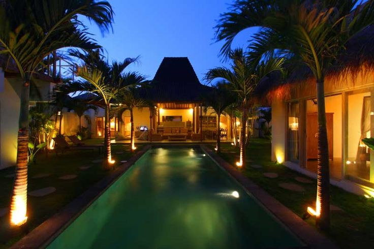 The #beautiful #joglo of the property overlooks the large #swimmingpool in its #tropical garden.