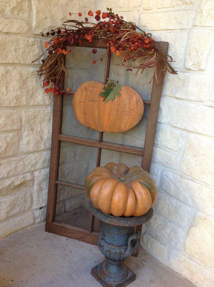 Use old window screen and antique urn to create a fall greeting on your front porch.