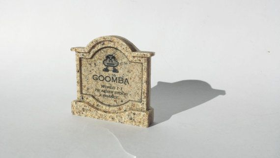 "This specific tombstones from the classic Mario Games, is Goomba.  Epitaph reads:  ""World 1-1, he never stood a chance..."" Available at www.ChinookCrafts.Etsy.com"
