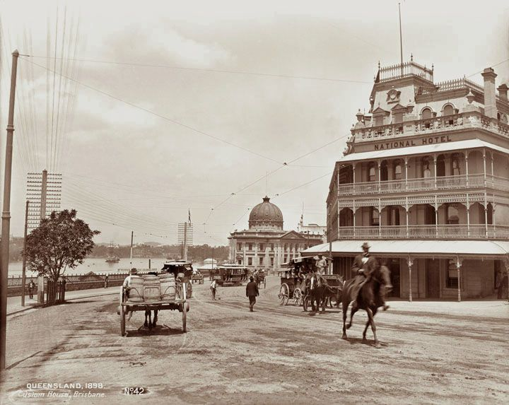 Petrie Bight showing National Hotel and Customs House, Brisbane 1898 - You can see the Brisbane River, along with horse-drawn vehicles, trams, telegraph poles, rider on horseback and a few men walking across the dirt road.