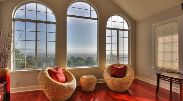 Asian Living Room with Arched window, Hardwood floors, Bubble Outdoor Wicker Lounge Chair