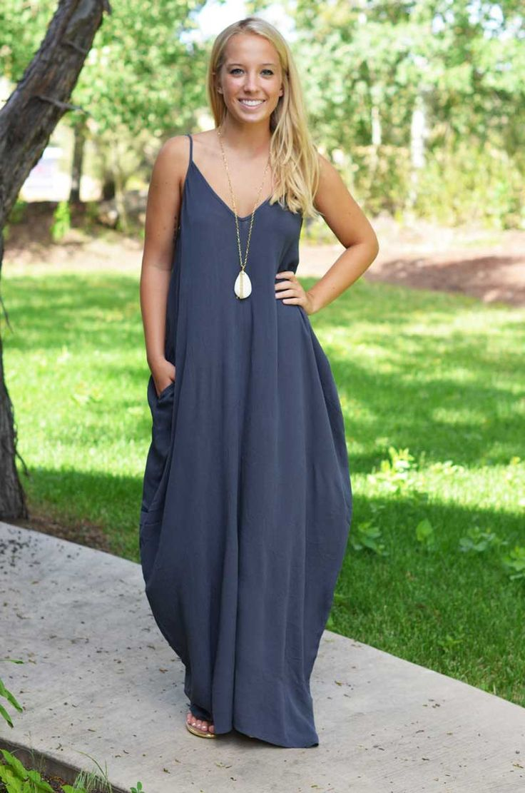Description This cocoon maxi dress is sleeveless, has a v-neck neckline and a comfy, cocoon-like fit with a pocket on each side! The brand is Love Stitch, which is one of our favorites! The straps are