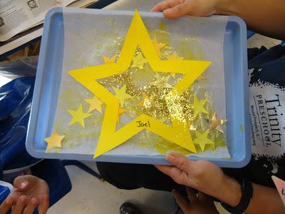 We used wax paper sheets that come in a box as the base for the art.         The children painted with yellow glitter paint with some glue...