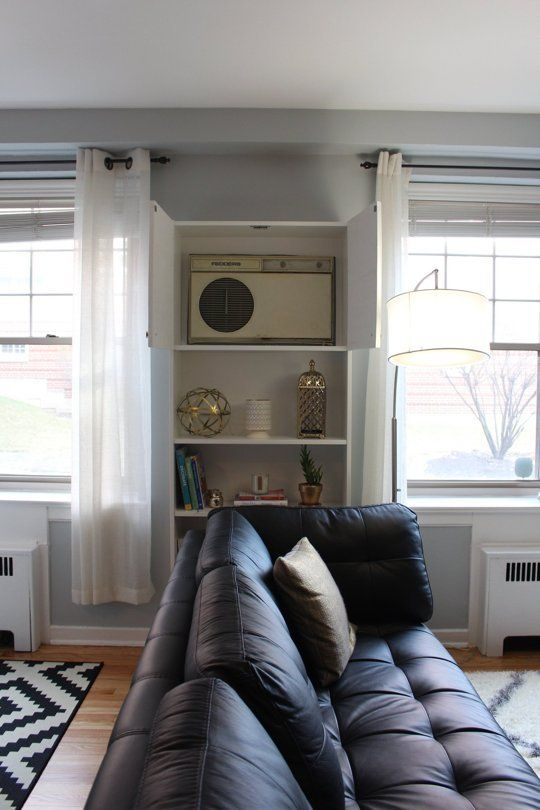 Bookcase with doors now covers the ugly AC wall unit. IKEA BILLY Hack: How to Cover Up An Ugly AC Wall Unit - Open the top doors when you turn it on and close it when you're done!