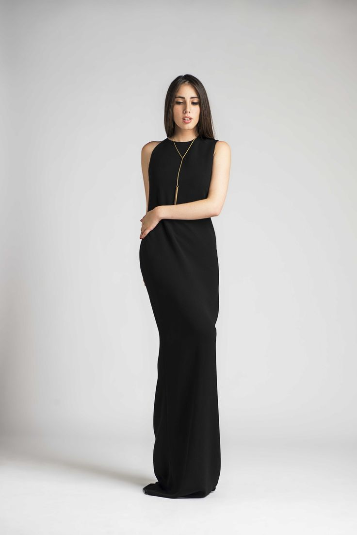 Long dress with asymmetrical straps. Designed by MARIA ROVIRA.
