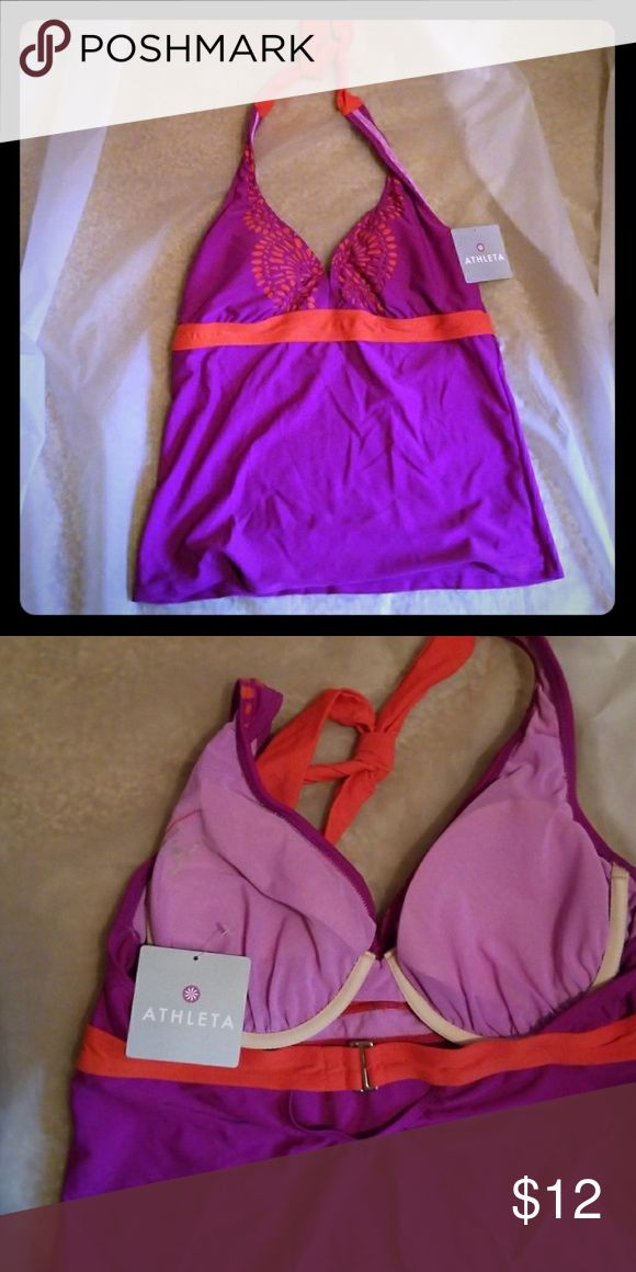 40B 38 C ATHLETA tankini Cute! Whether you're hunting for the perfect set, paddling along the shore, or just taking in the sun, this tankinii with removable QuickDri cups has you covered. This is the top only. Purple and orange with cut out pattern on chest. Swim Bikinis