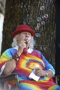 "Wavy Gravy (born Hugh Nanton Romney) (born May 15, 1936) is an American entertainer and activist for peace, best known for his hippie appearance, personality and beliefs. His moniker (the name he uses day to day) was given to him by B.B. King at the Texas International Pop Festival in 1969.[1] ""It's worked pretty well through my life,"" he says, ""except with telephone operators – I have to say 'Gravy, first initial W.""[2]    Romney's clown persona resulted from his political activism…"