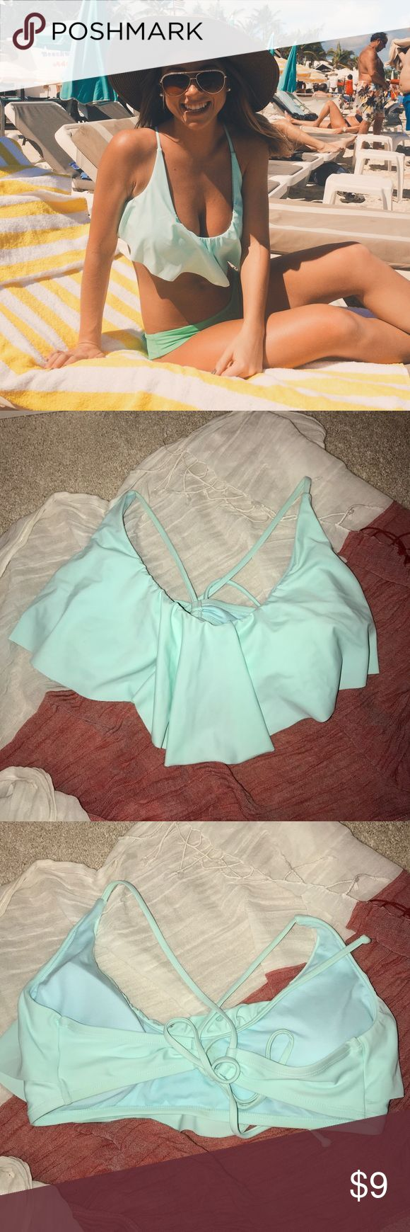 Mint colored bikini bathing suit top In great condition other than a small mark on the inside of the bathing suit not visible when worn. Mint colored. Originally from target. Great coverage. Fits mostly like a Large (cup D). Xhilaration Swim Bikinis