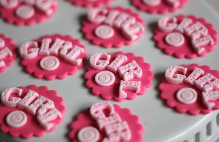 It's a Girl!  fondant cupcake toppers.  Available at https://www.etsy.com/shop/LesPopSweets?ref=hdr_shop_menu