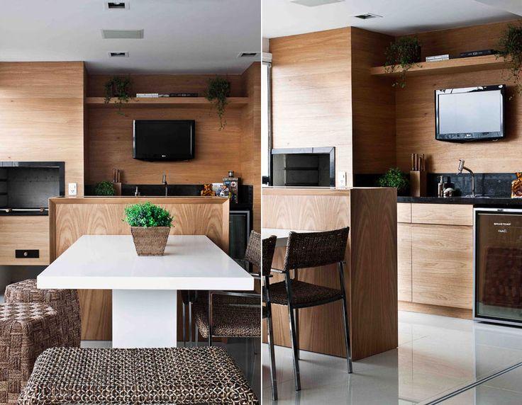 churrasqueira de granito e madeira25- Varanda integrada com a sala + churrasqueira com acabamentos em madeira e granito preto + mesa de silestone branco. Projeto Andrezza Alencar.