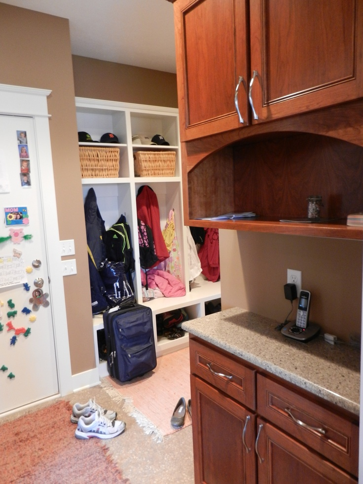 Drop zone with cubbies by laundry room