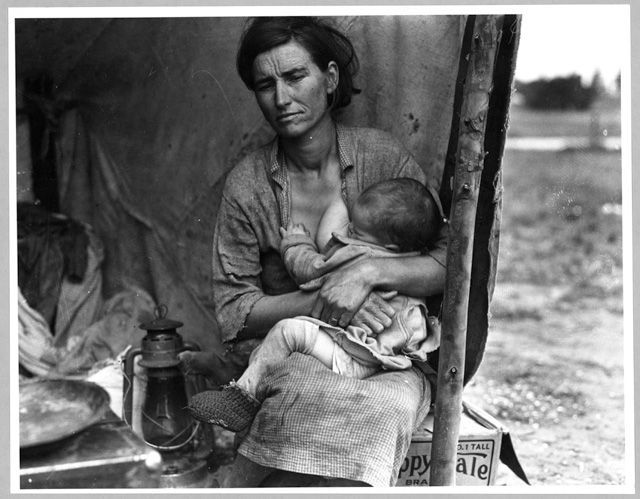 Florence Owens Thompson, breast feeding one of her children [powerful image of the poverty of the great depression 1930s America].