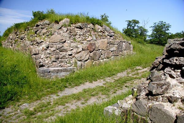 The only part of Gamleborg Viking fortress that was built as a permanent construction was the wall, which exists till this day.   The king's castle and the living quarters for the varied population in the fortress were made of materials that   have not survived. Gamleborg was built around 750 AD as the residence of the king of Bornholm and continued   as such until it was finally abandoned.