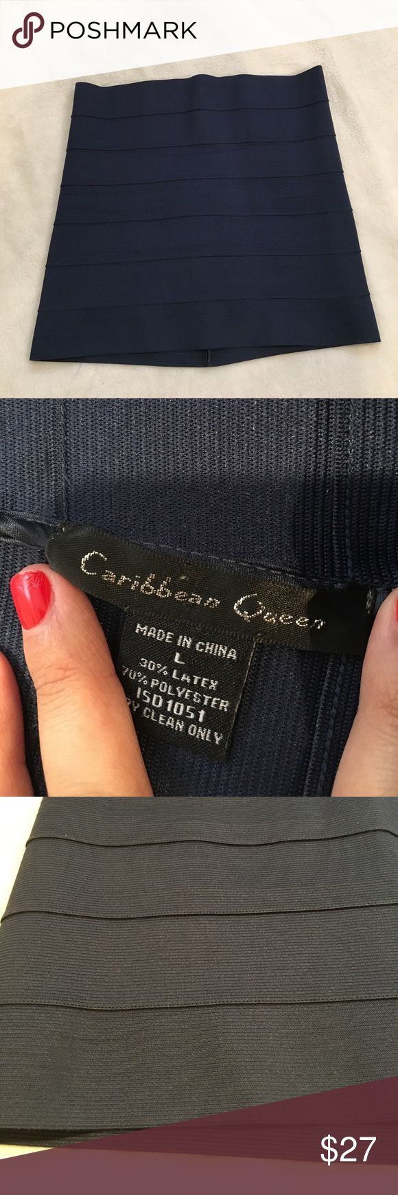Caribbean Queen Navy bandage skirt very tight fitting navy bandage/pencil skirt! in very good condition only worn a few times! has striped detailing down the skirt. very fun and flirty and perfect for any occasion! has a label with a name scribbled over because it had my name previously in it ☺️ caribbean queen  Skirts Pencil