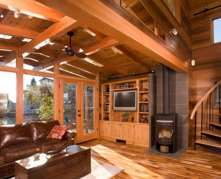 Glamorous pellet stoves for sale in Living Room Rustic with Acacia Floors next to Acacia Wood Floor alongside Wood Stove Hearth and Built In Entertainment Center