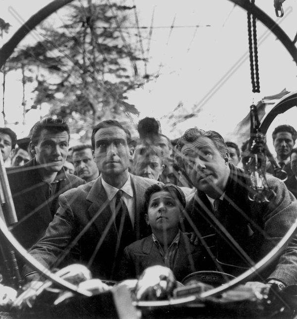Lamberto Maggiorani, Enzo Staiola, and Vittorio De Sica while filming BICYCLE THIEVES (1948)