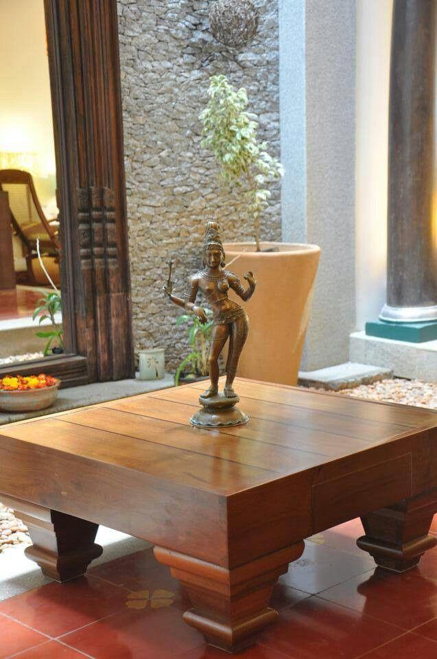 Statue on teak wood