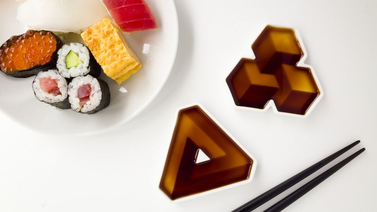 Soy sauce dipping dishes that give the illusion of impossible three-dimensional shapes. Made in Japan.