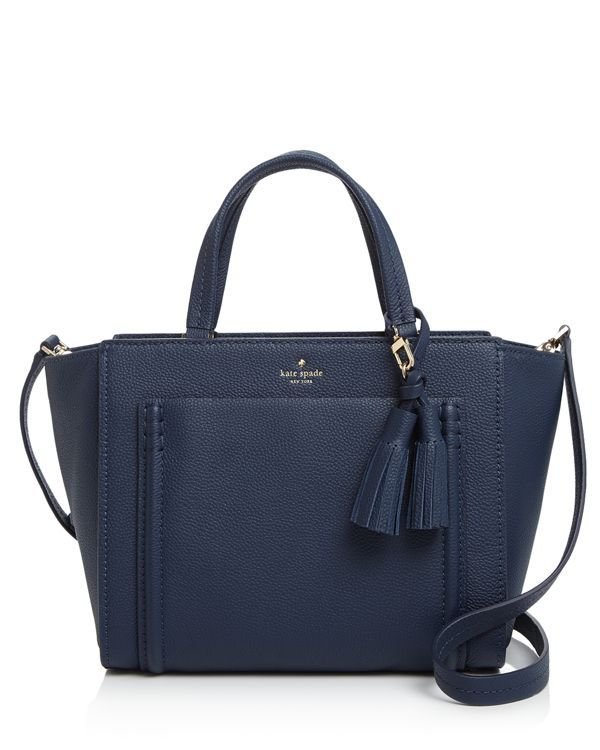 Pebbled leather, winged sides and a detachable tassel detail make this right-sized kate spade new york tote with optional shoulder strap look really rich.   Shell: Leather; lining: polyester   Importe