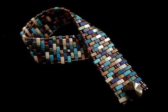 love this eye-catching unique use of Miyuki half tilas--love this bracelet--Beadbound description:  Beadwoven Bracelet with MultiColored Half Tila Beads by beadbound, $40.00