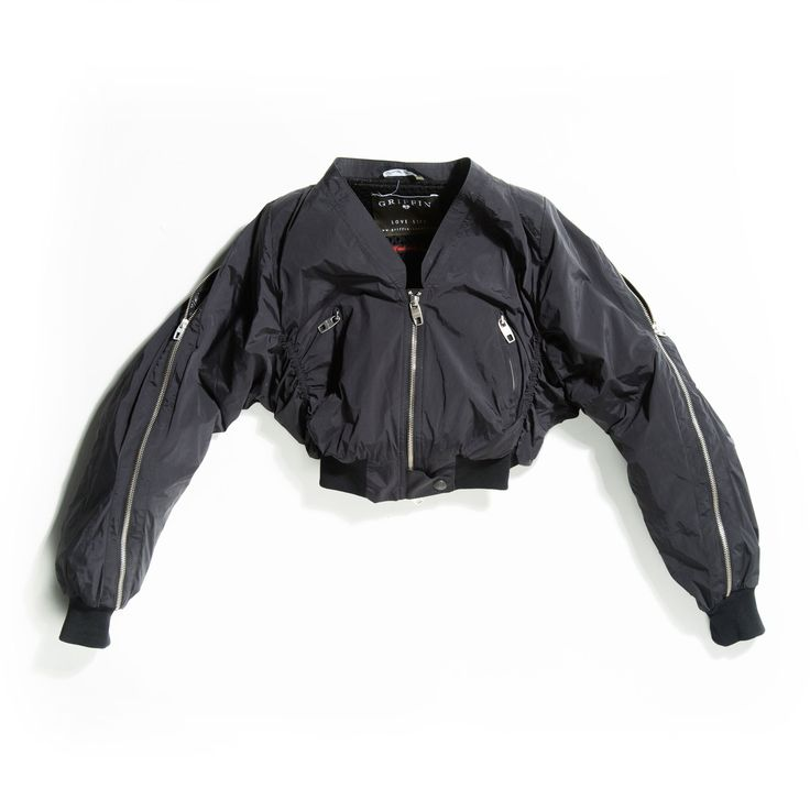 #Griffinstudio Womens Nat Bomber, first developed by Griffin in 2002, is a great Bomber with a lot of attitude. Made in an Italian stretch nylon to give form, structure and comfort, it also features a zip wrapping around the arm. Lined in Black Mesh from Scheoller, it mixes luxury and technical fabrics together with distinctive Griffin features such as military, craftsmanship and sportswear. #Griffin #womanswear #LoveLife #Fashion #SS15 #luxury