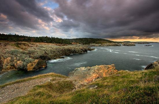 Cloudy morning a little after sunrise near the Louisbourg Lighthouse Cape Breton Nova Scotia Canada.