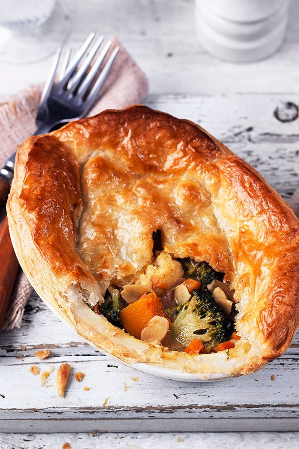 Gorgeous, golden puff pastry sits atop tons of winter veg beautifully spiced with ginger, madras curry powder and creamy coconut milk to make thee delicious Indian-inspired pies | Tesco