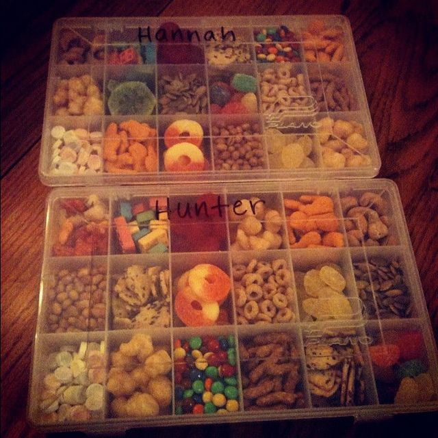 Road Trip Snack Boxes for Kids - I found the boxes in the craft section at Wal-Mart and included a variety of salty and sweet treats. Then on each leg of our trip (divided up into 1-2 hour increments), they could choose one or two things to eat. Very convenient on us as parents and the kids love it, too.