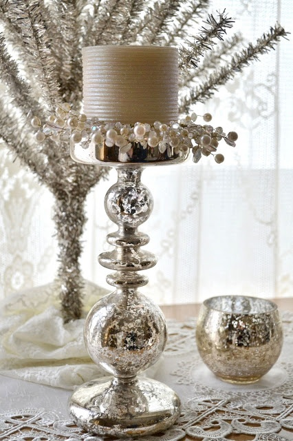 Jennelise: Glitter of Winter   Shopping around for old lamp bases, paint and make lovely candle stands, then group them together onto table etc. Also do this to theme ur favorite holiday, using pastels for Easter or red and gold for Christmas, using colored candles flowers