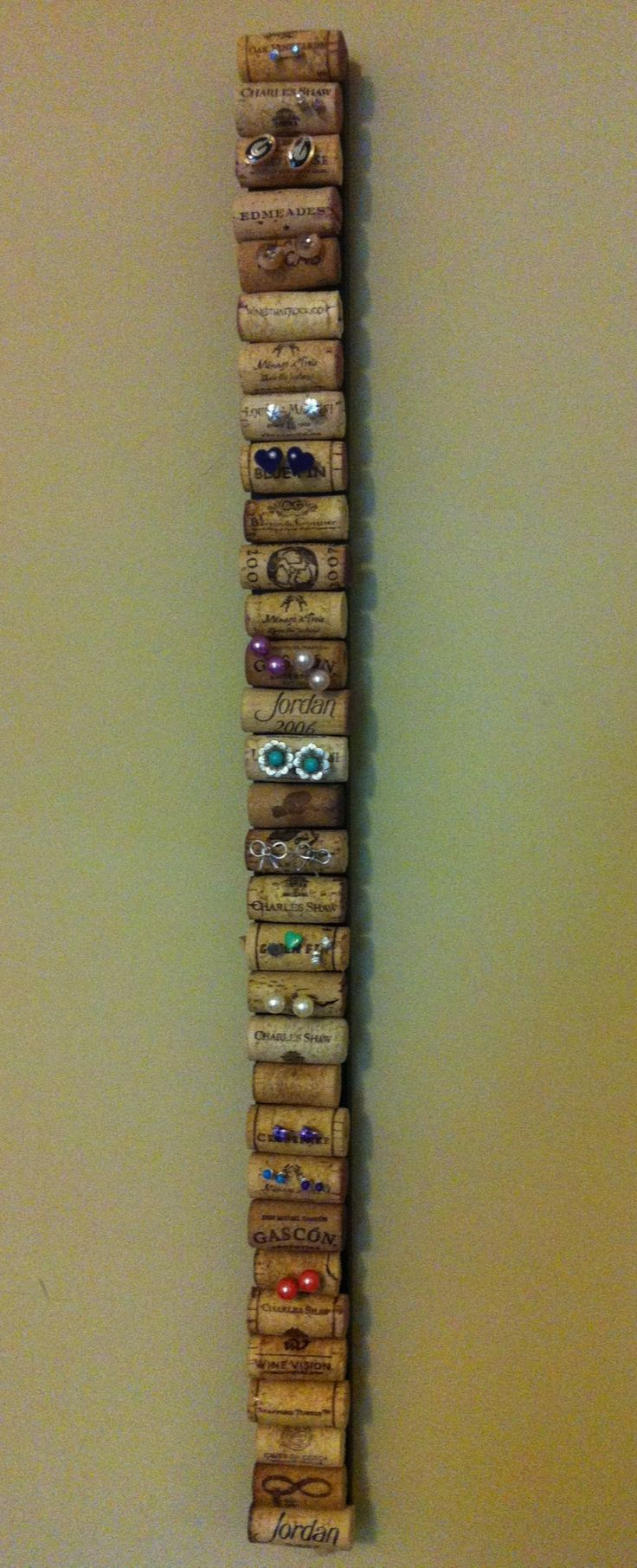 Post earring holder. Scrap wood, corks, hot glue