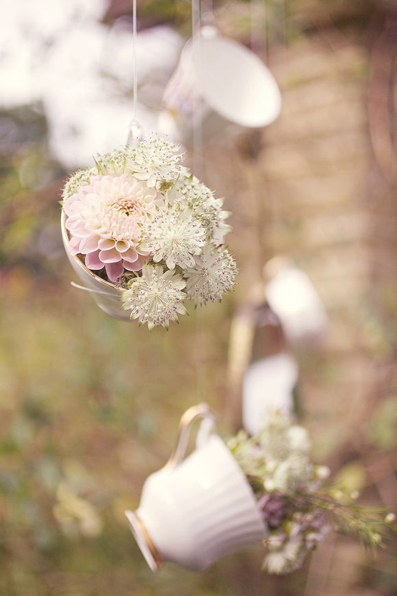 Flowers in teacups... hanging from trees or centerpieces?