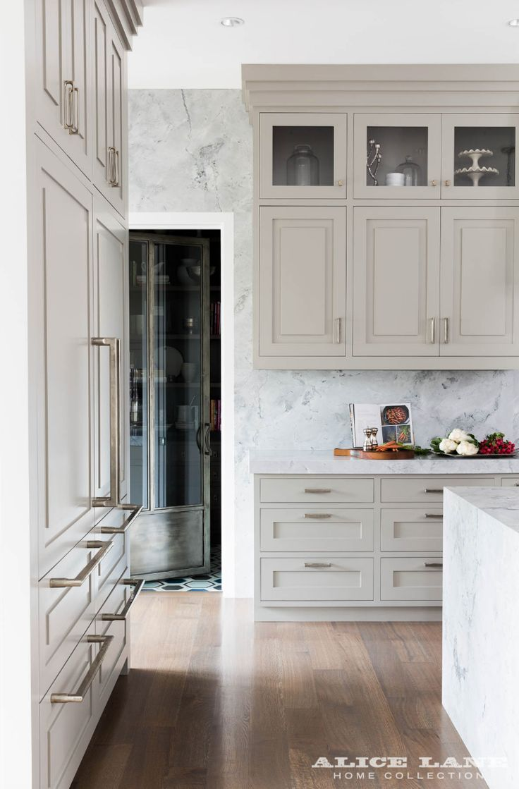 In love with that custom cabinetry color, and that marble is to die for! Designed by Alice Lane Home Photo by Nicole Gerulat